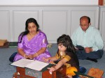 A family sings devotional songs in the temple