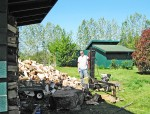 A volunteer splits firewood for the winter ahead